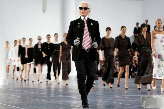 German designer Karl Lagerfeld appears at the end of his Spring/Summer 2013 women's ready-to-wear fashion show for French fashion house Chanel during Paris fashion week